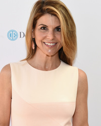 Lori Loughlin Shows Off Fit Physique While Striking an Insane Yoga Pose