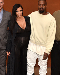 Kim Kardashian Bares Her Baby Belly In Totally Sheer Onesie
