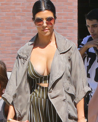 Kourtney Kardashian Flaunts Crazy Cleavage as Kim Shows Off Her Baby Bump