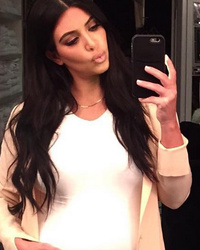 Kim Kardashian Wishes Her Baby Goodnight -- And Her Bump Looks Huge!