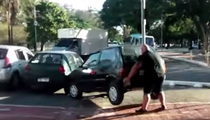 Hulking Cyclist -- Moves Car Out Of Bike Path ... By Picking