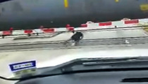 Man Defies Death -- Rolls Under Moving Train!!