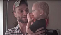 Cutest Reaction -- Baby Loves Playing In The Rain With Dad (VIDEO)