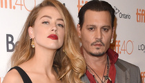 "Johnny Depp and Amber Heard Show Major PDA at ""Black Mass"" Premiere"