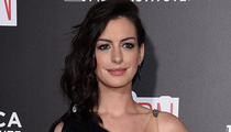 What the Heck Did Anne Hathaway Just Wear on the Red Carpet?!