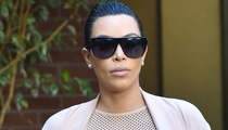 Kim Kardashian Puts Baby Bump on Display In Nude Sheer Dress