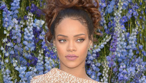 Rihanna Goes Glam at Dior's Paris Fashion Week Show -- But WTF Is Leelee Sobieski Wearing?!