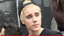 Justin Bieber Off Formal Probation ... He Got His Hands Dirty