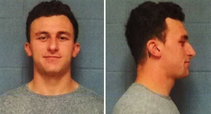 Johnny Manziel -- Smirky Mug Shot ... Booked in…