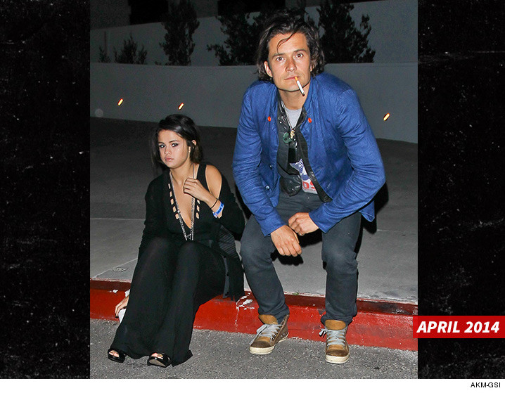 0510-selena-gomez-orlando-bloom-smoking-april-2014-together-AKMGSI-01