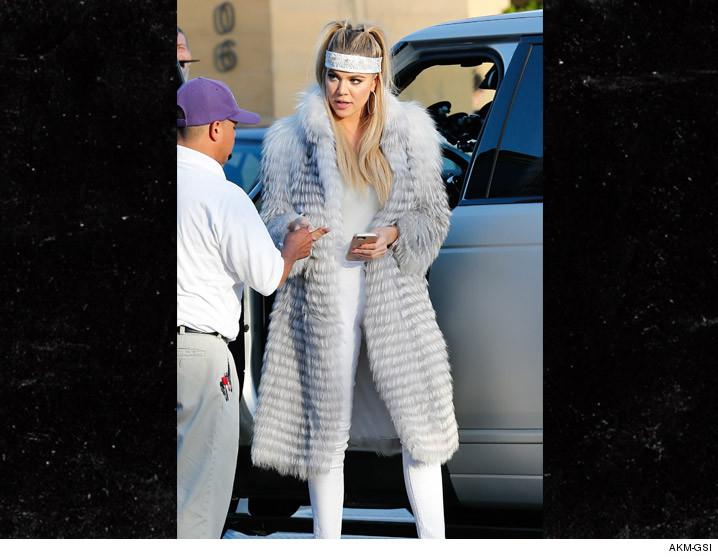 0527-khloe-kardashian-headband-akmgsi-02