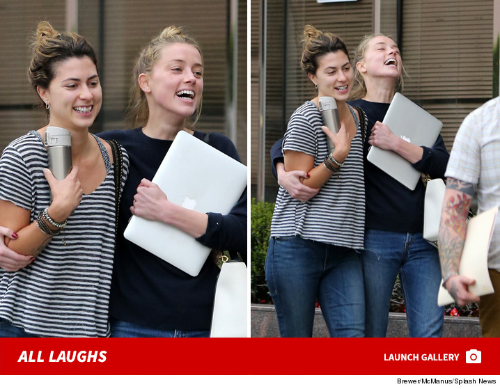 0529-amber-heard-all-laughs-after-filing-for-divorce-gallery-LAUNCH-SPLASH-01