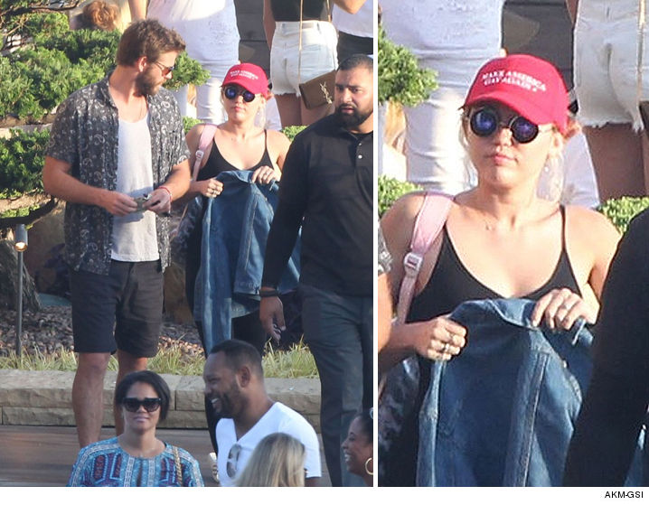 0725-miley-cyrus-liam-hemsworth-make-america-gay-again-hat-AKMGSI-01
