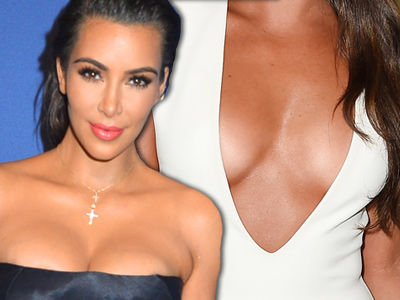 Someone Upstaged Kim In the Cleavage Department -- And It's SO Unexpected From Her!