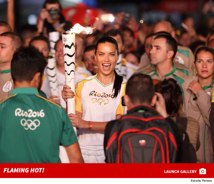 0805_adriana_lima_olympic_torch_launch_2