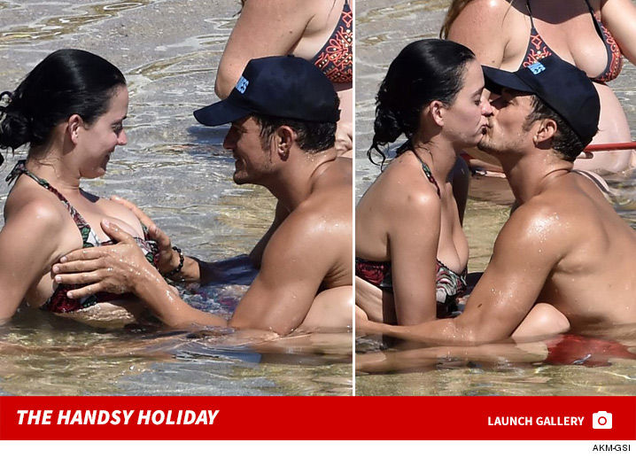 0810_katy_perry_orlando_bloom_vacation_footer_2