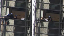 Trump Tower -- Man Scaling Tower with Suction Cups