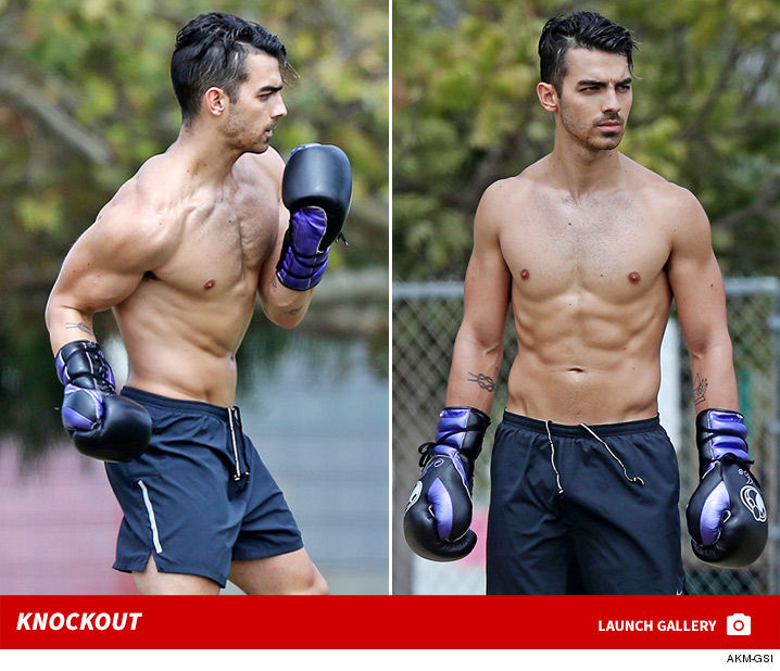 0914_joe_jonas_shirtless_boxing_launch_2