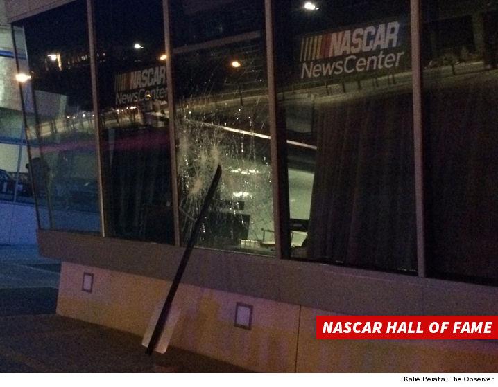 0922-nascar-store-burglary-smashed-glass-KATIE-PERALTA-OBSERVER-01