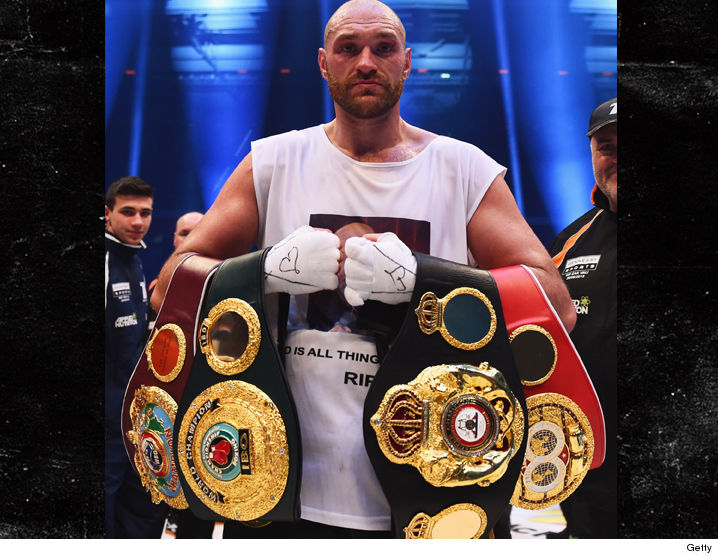 1012_tyson_fury_and_belts_getty