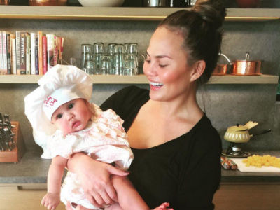 "Chrissy Teigen Feeds Baby Luna Her First ""Savory"" Bite Of Food -- This is ADORABLE!"