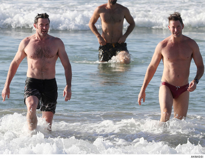 1219-hugh-jackman-muscles-beach-swimming-AKMGSI-01