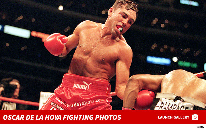0125-Oscar-De-La-Hoya-fighting-boxing-photos-footer