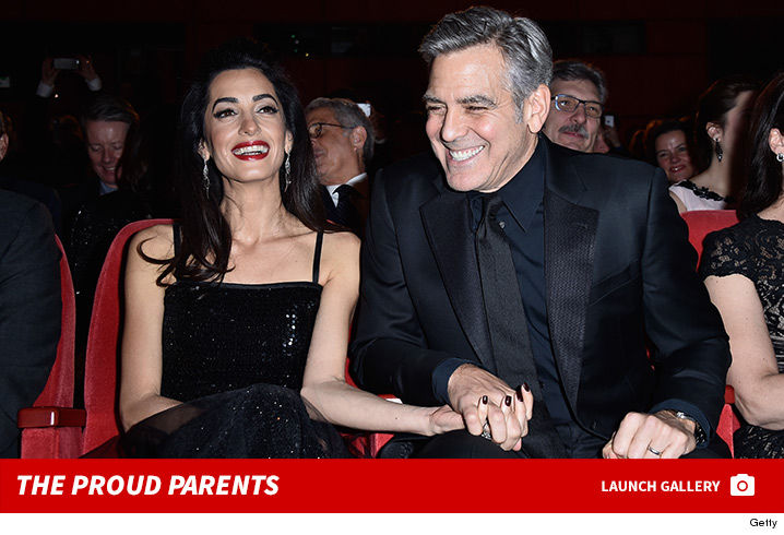 0209-George-Clooney-Amal-Proud-Parents-footer