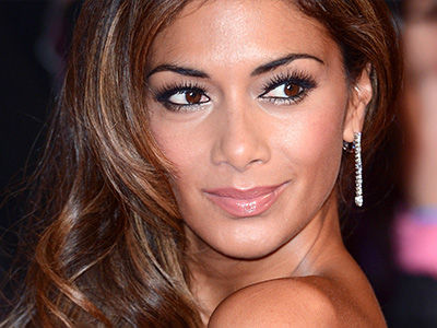 Nicole Scherzinger Shows Off Her Backside as She Steps Out in See-Through Dress