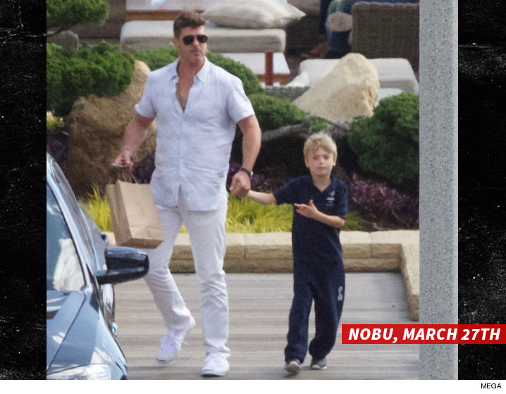 0329_robin_thicke_and_son_MEGA-swipe