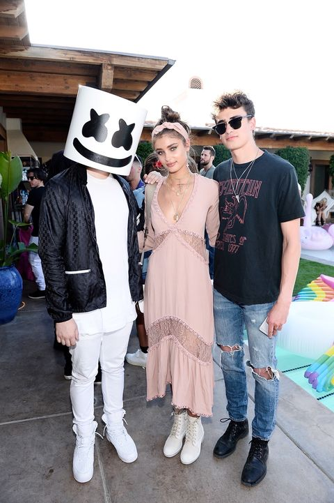Marshmello, Taylor Hill and guest attend Victoria's Secret Angels Celebrate the Sexy Little Things Launch at the Angel Oasis on April 14, 2017 in Indio, California.