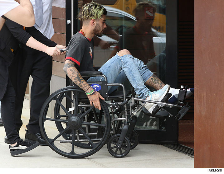 Zayn Malik spotted in a wheelchair in NY