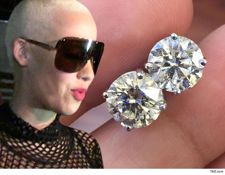063016-amber-rose-earrings-tmz