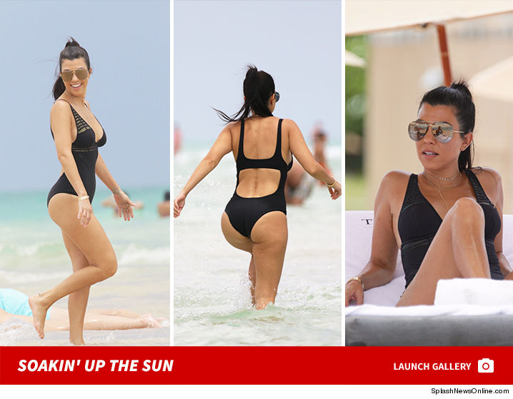 0702-kourtney-kardashian-bikini-gallery-launch-splash-01